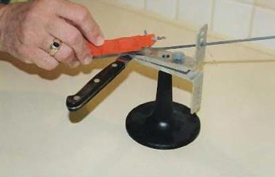 Person sharpening knife with alternative system