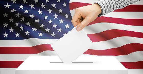 Image of a ballot being cast, with American flag in the background